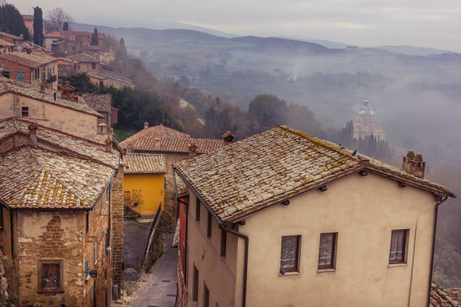 This is Montepulciano, Italy in late November. On a 12 day painting and photography trip, we faced many foggy mornings. Sometimes the fog didn't lift until afternoon. A local gave us a tip that we could escape the fog by going higher into the hill towns. I really love the contrast of the rough textured roofs against the soft somber background. The challenge with editing was to bring out the buildings without undoing the over-all softness of the scene.